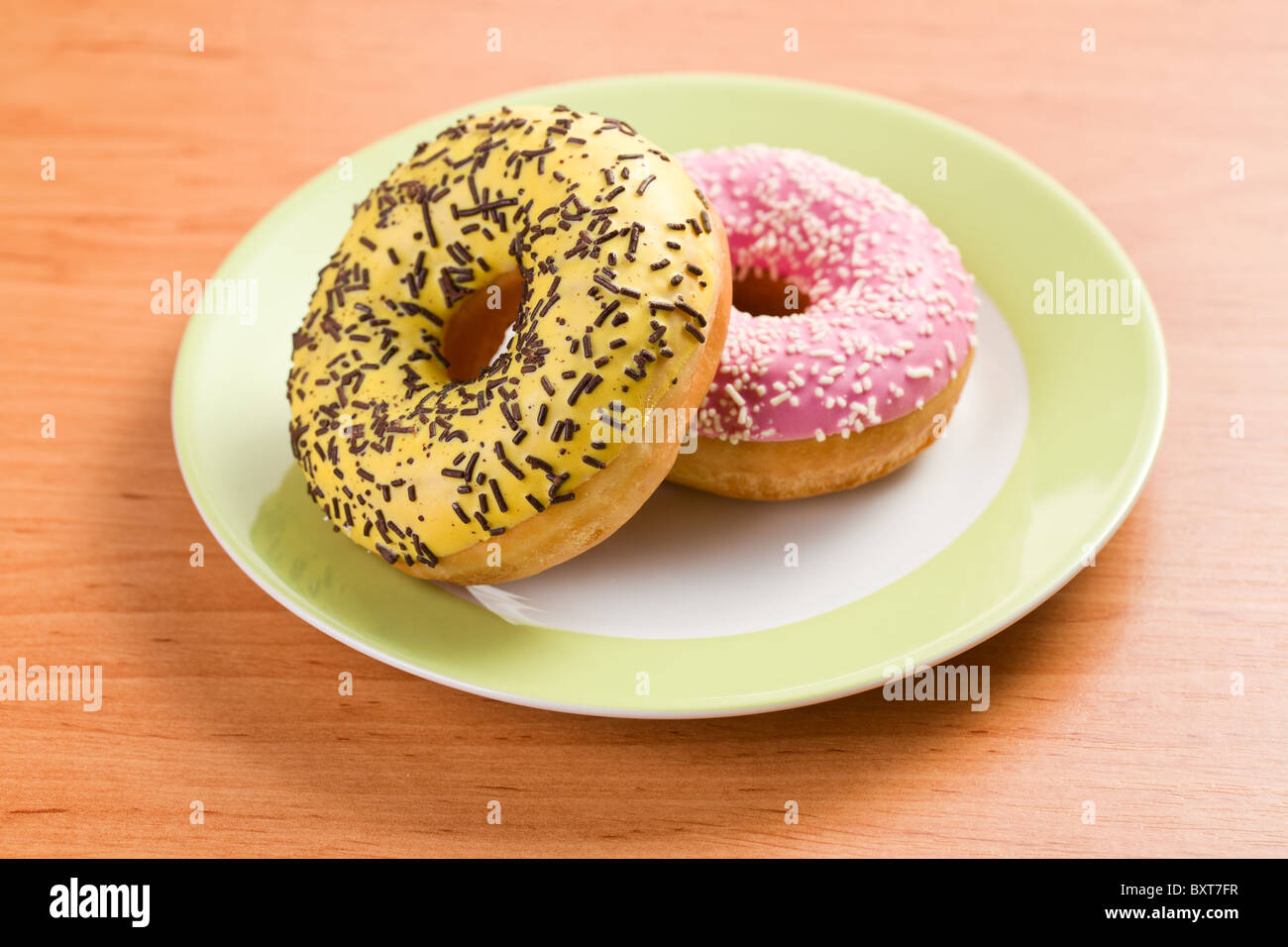 the sweet doughnuts on plate - Stock Image