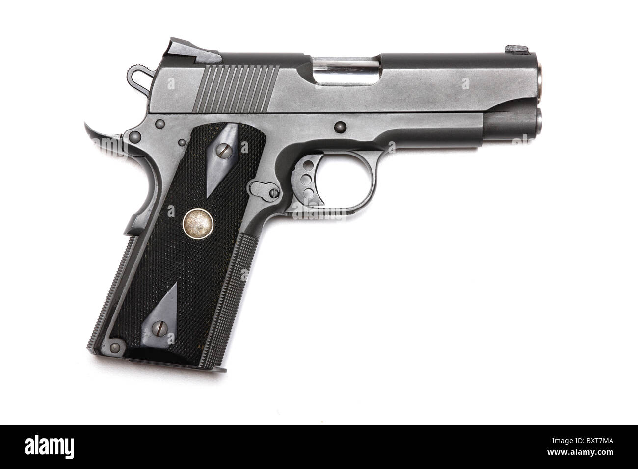 Weapon series. 1911-family handgun with 4.3' barrel. Isolated on a white background. Left side view. Studio - Stock Image