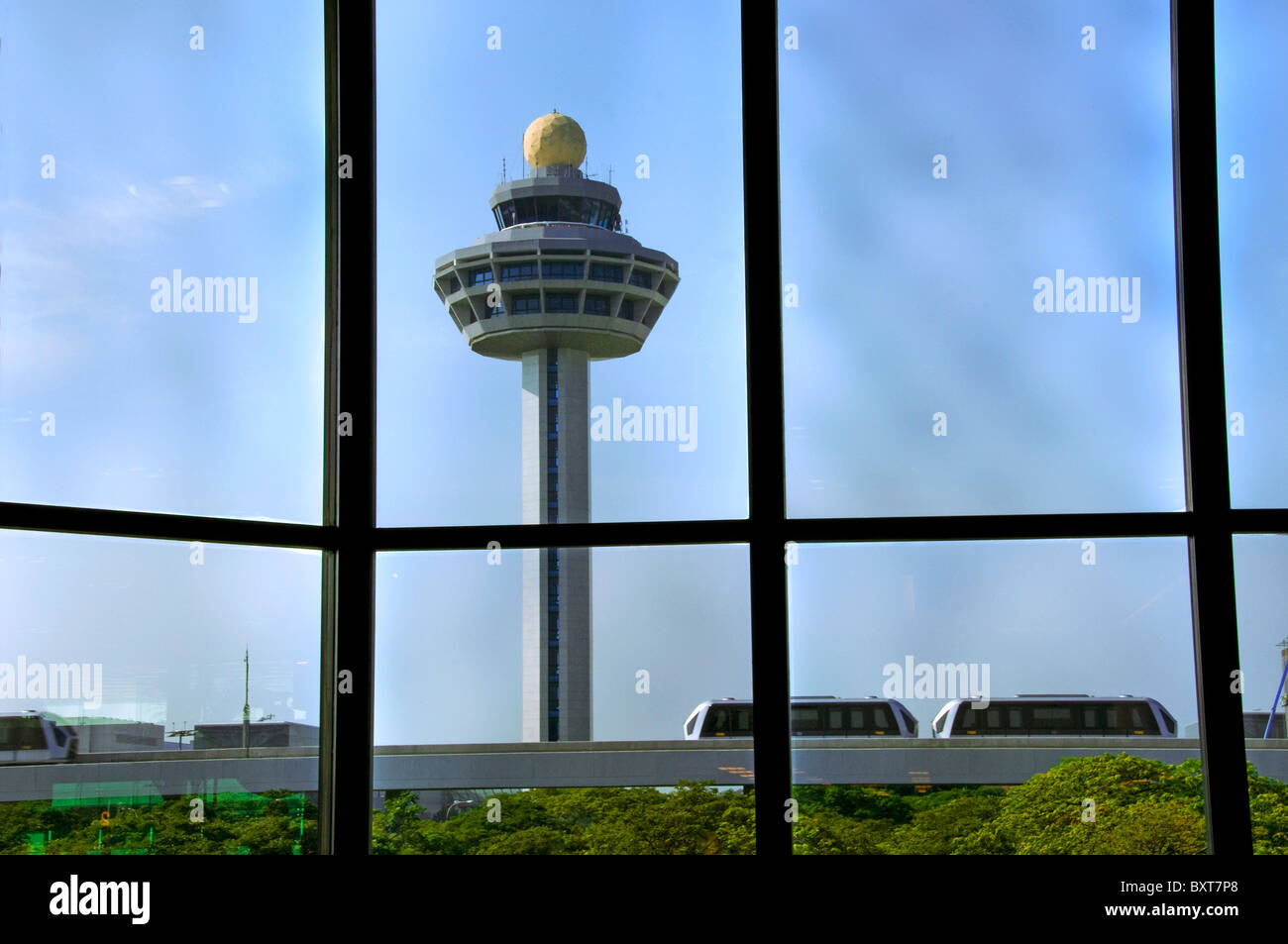Flight control tower at new modern airport terminal in Singapore southeast Asia - Stock Image