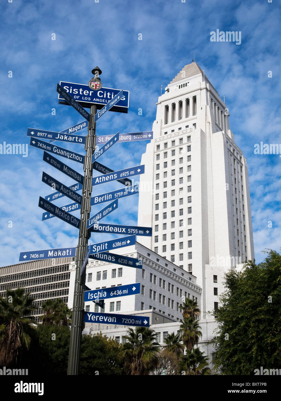 Los Angeles City Hall and the sister cities street signs. - Stock Image