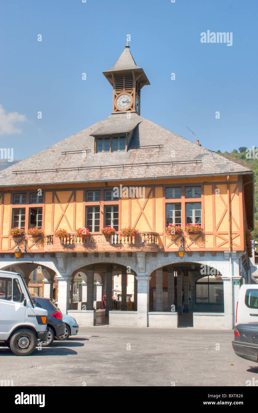 The 17th century Halles in Arreau the Capital of the Quatre Vallees on the route to the Col d'Aspin in the High - Stock Image