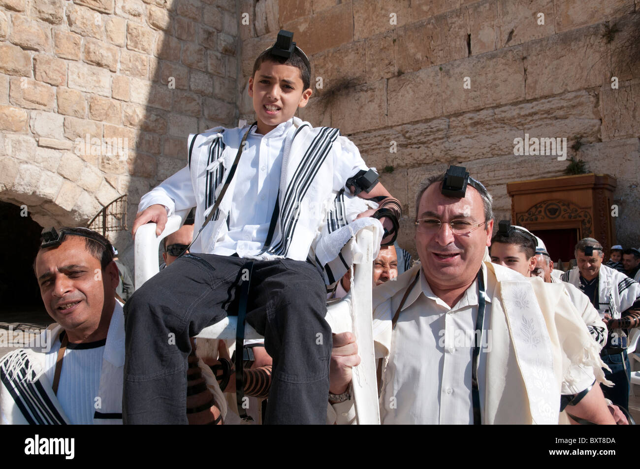 Western Wall. youngster being lifted on a chair during his Bar Mitzvah ceremony. Jerusalem Old City - Stock Image