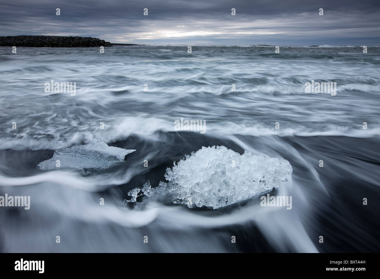 Iceland Skaftafell National Park Motion blur image of icebergs from Vatnajokull Glacier in waves from North Atlantic - Stock Image
