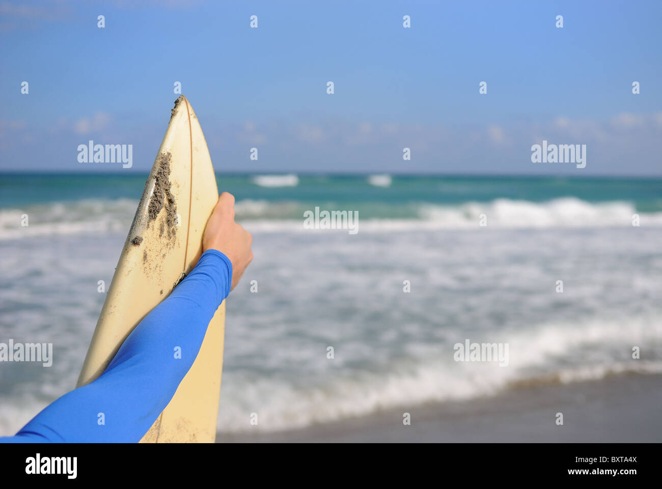 Surfer holding his board - Stock Image