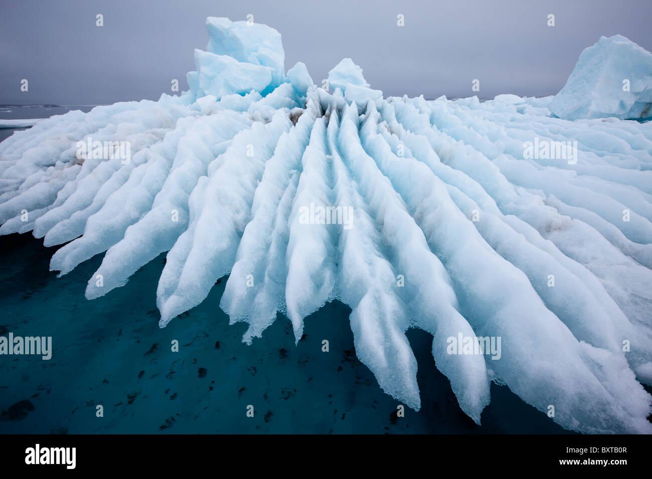 Norway, Svalbard, Nordaustlandet, Jagged patterns in melting sea ice in fog along Wahlberg Island - Stock Image