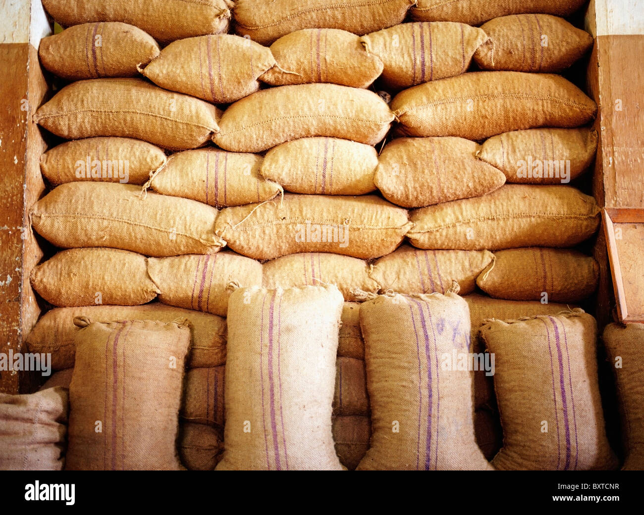 Burlap Sacks Stacked Up In A Nutmeg Factory - Stock Image