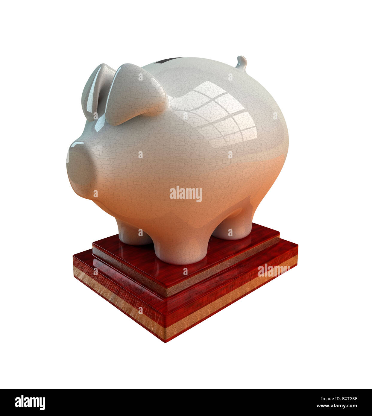 Antique white piggy bank on ornate wooden base. Cut out. - Stock Image