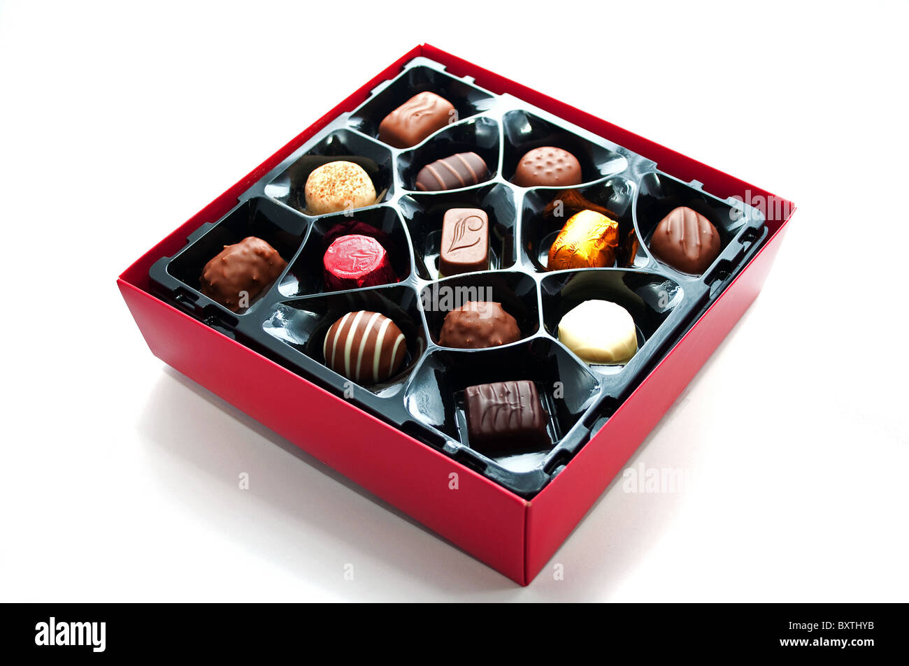 A box of Thorntons chocolates on a white background - Stock Image