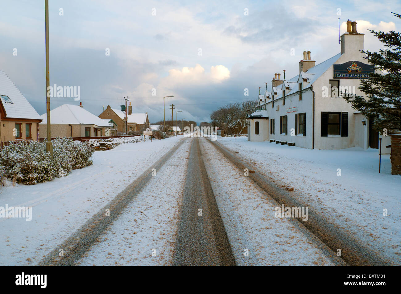 The main Thurso to John o'Groats road, the A836, snow covered in winter.  At the village of Mey, Caithness, - Stock Image