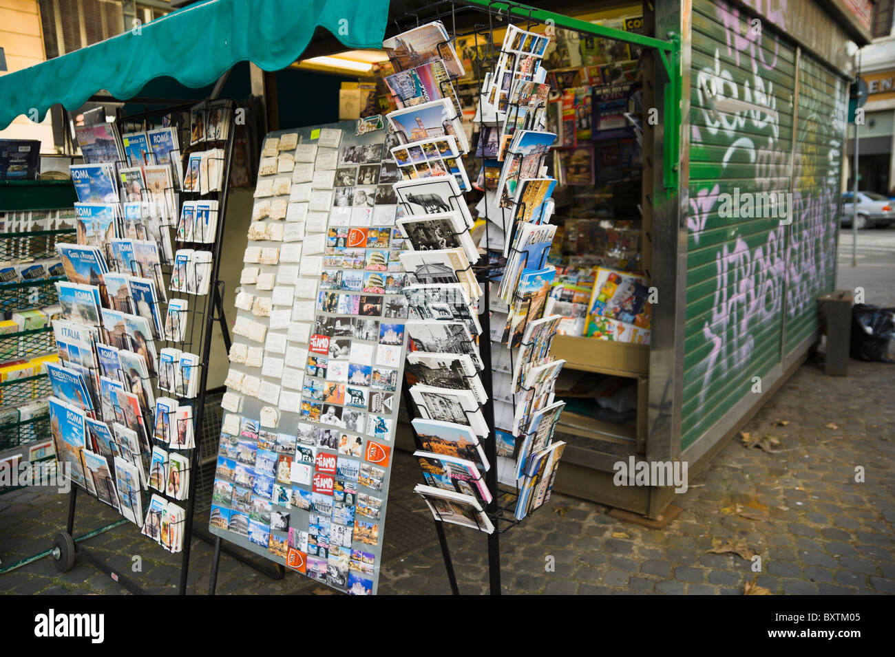Rome, newsagent kiosk selling postcards, stickers and tourist guides. - Stock Image