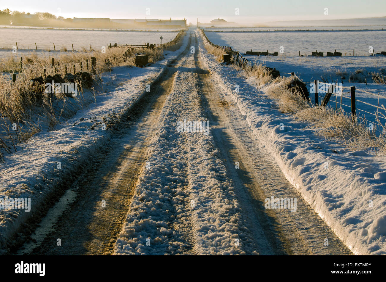 Snow covered road at Scarfskerry, Caithness, Scotland, UK - Stock Image