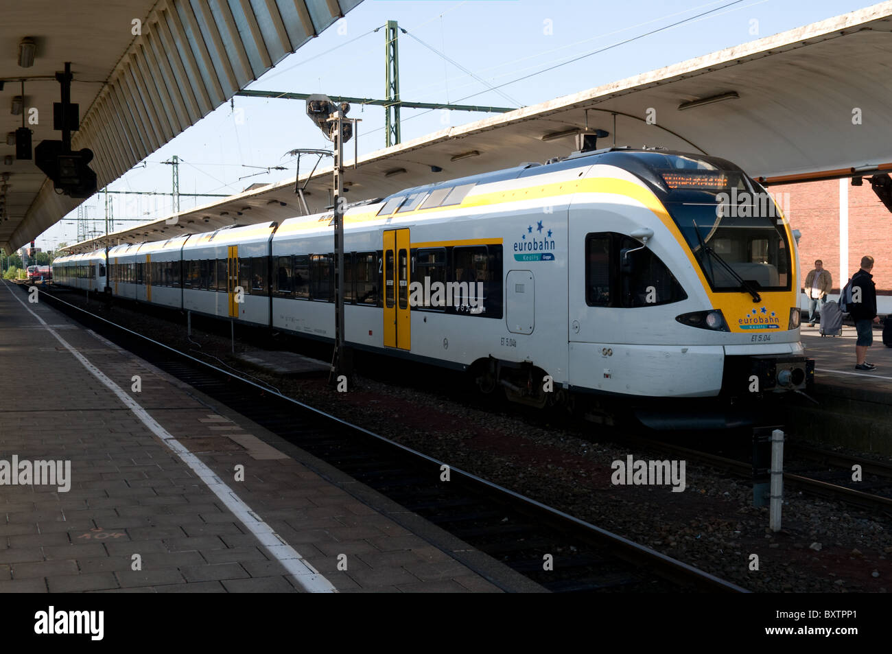 A two set Eurobahn electric multiple unit train waits in Munster station. - Stock Image
