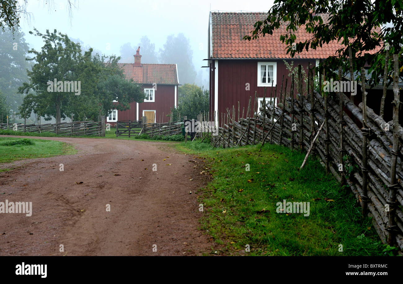 Old swedish farmstead with wooden fence - Stock Image