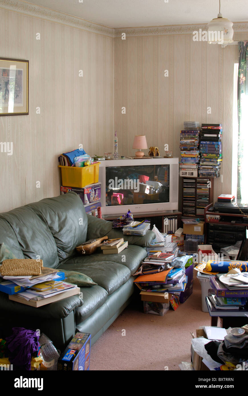 Very Messy And Untidy Cluttered Lounge Room With Books