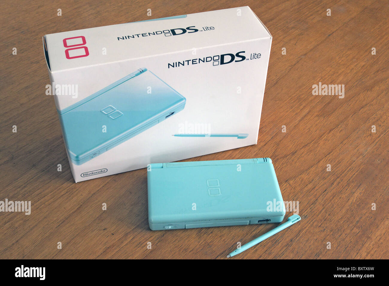 Nintendo DS Lite Handheld Games Console with box packaging, UK - Stock Image