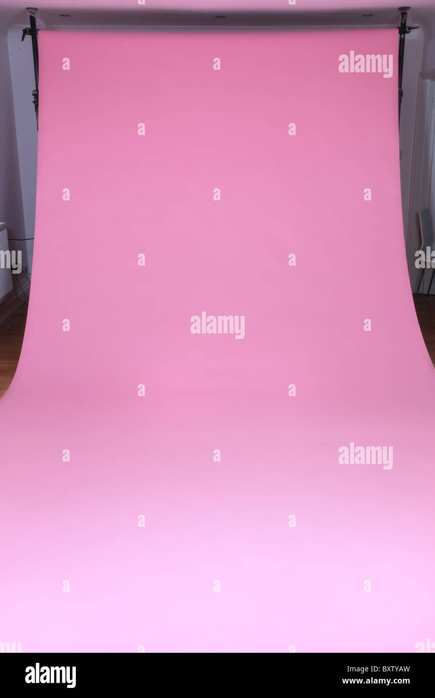 Carnation photographic studio backdrop supported by stands - Stock Image