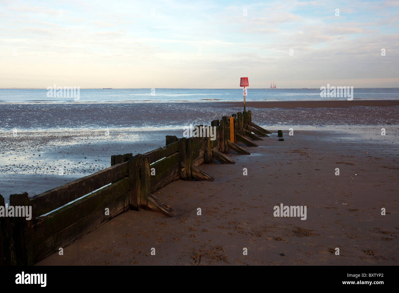 Cleethorpes sea front, sea defences looking out to sea on the Humber Estuary blue sky day - Stock Image