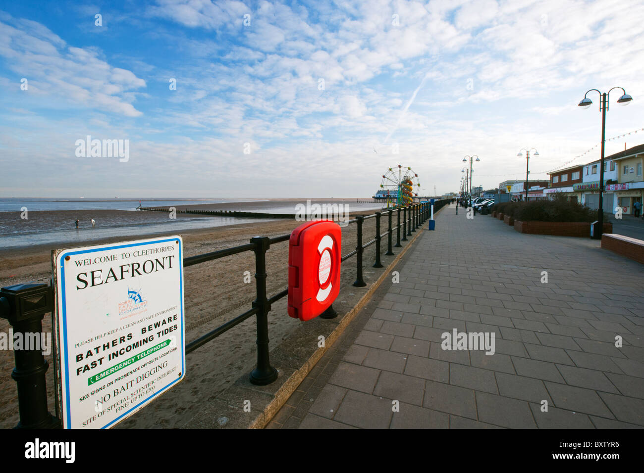 Cleethorpes sea front, pier, amusements, kids rides, ferris wheel slide blue sky day - Stock Image