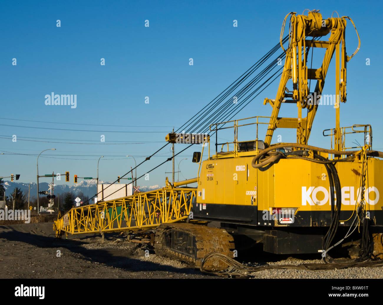crawler crane with boom lowered - Stock Image