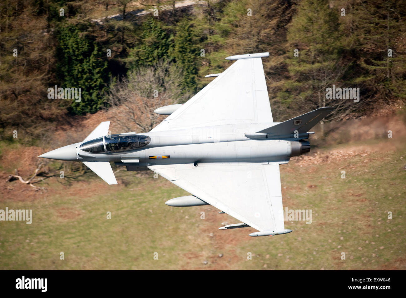 A Eurofighter Typhoon F2 aircraft of the Royal Air Force low flying over North Wales. Stock Photo