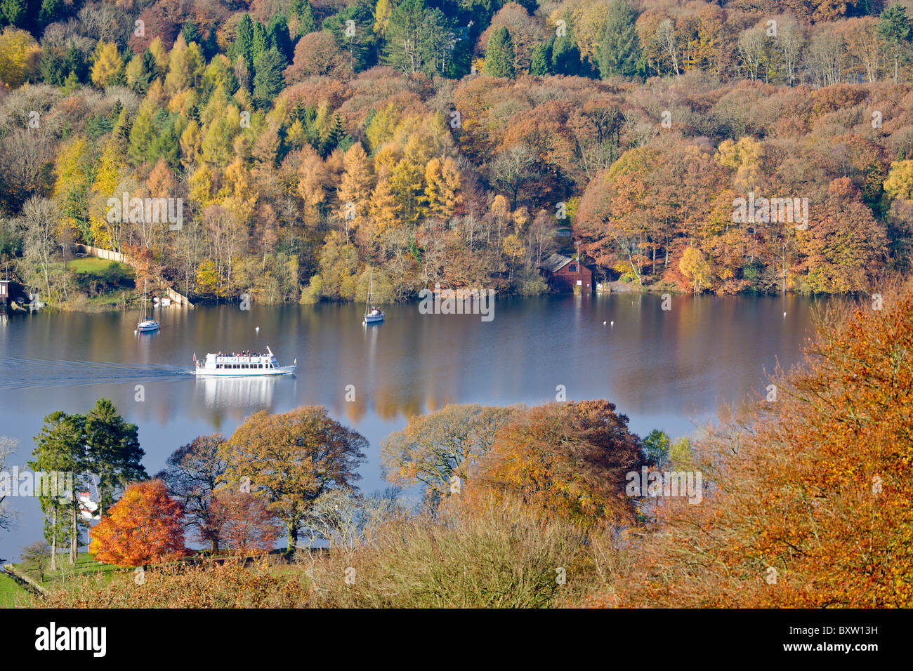Tour Boat on Lake Windermere in Autumn, Cumbria, England - Stock Image