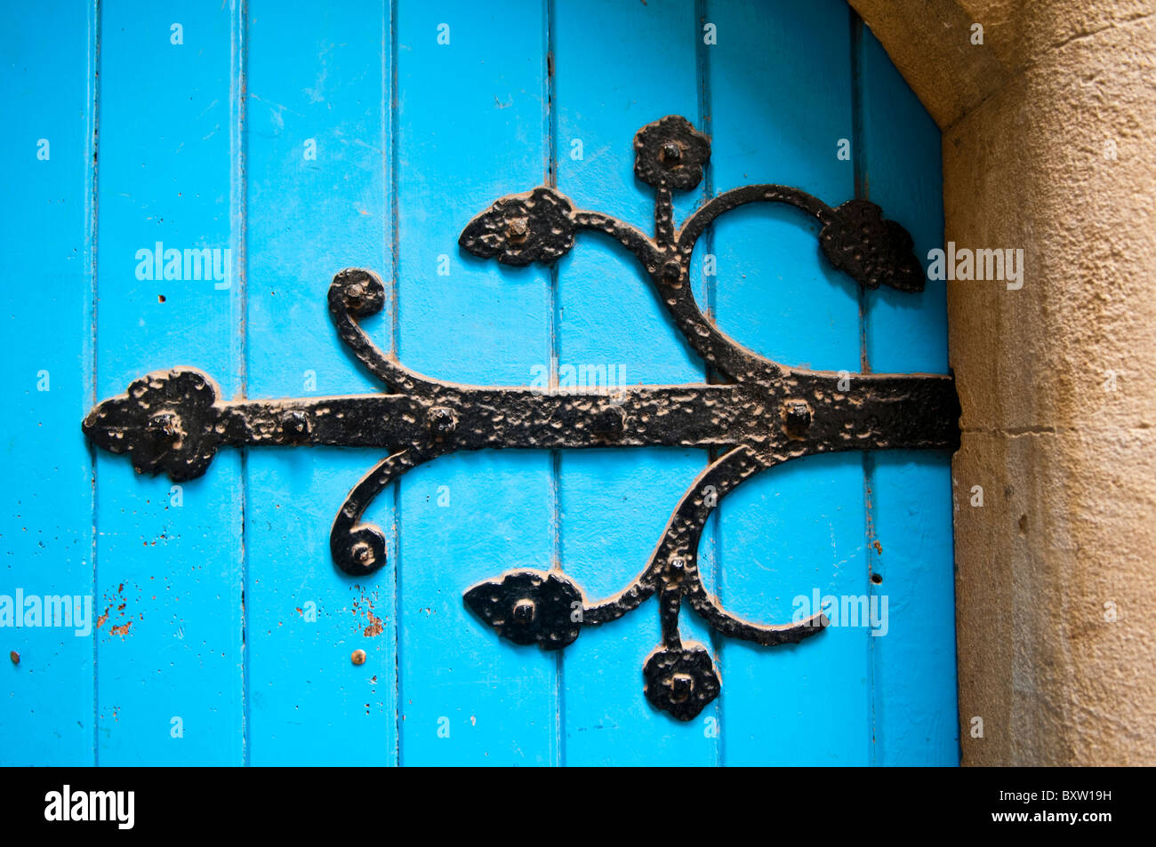 Ornate hinge bracket on a church door - Stock Image