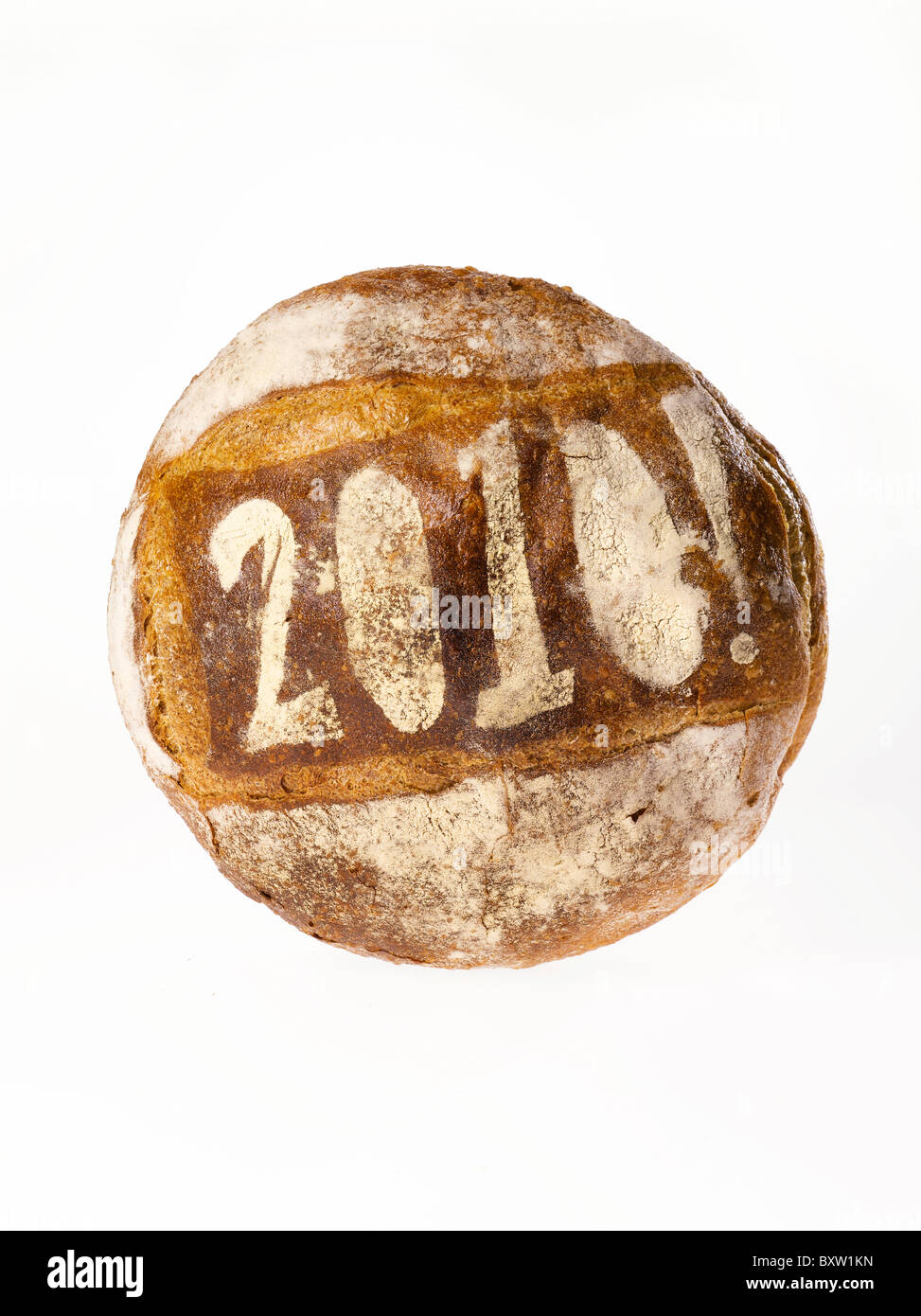 round loaf of bread stenciled with the year 2010 - Stock Image