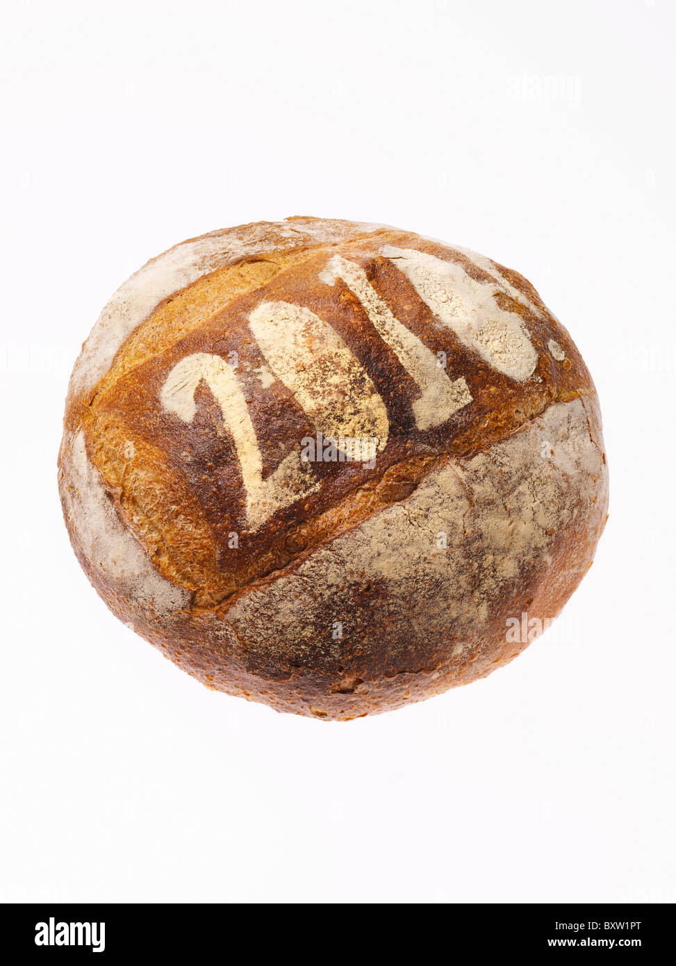 round loaf of bread dusted with the year 2010 - Stock Image