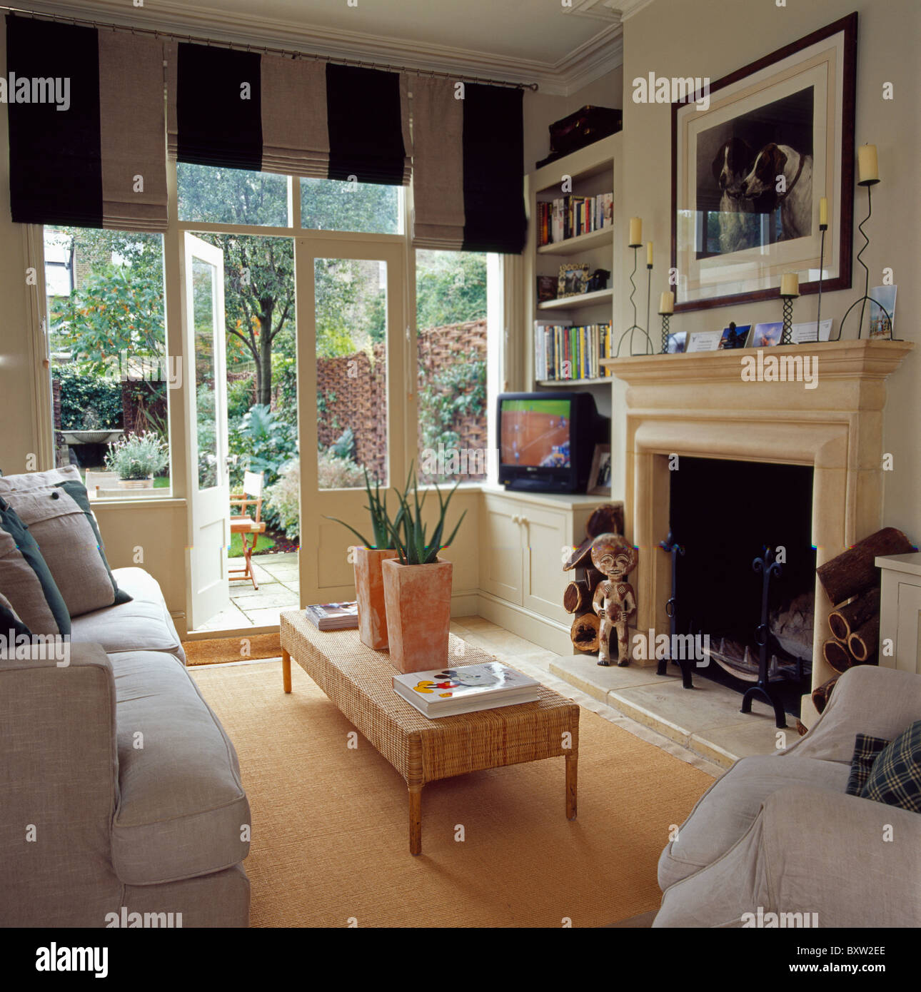 Wide-striped black+white blinds on French windows with view ...
