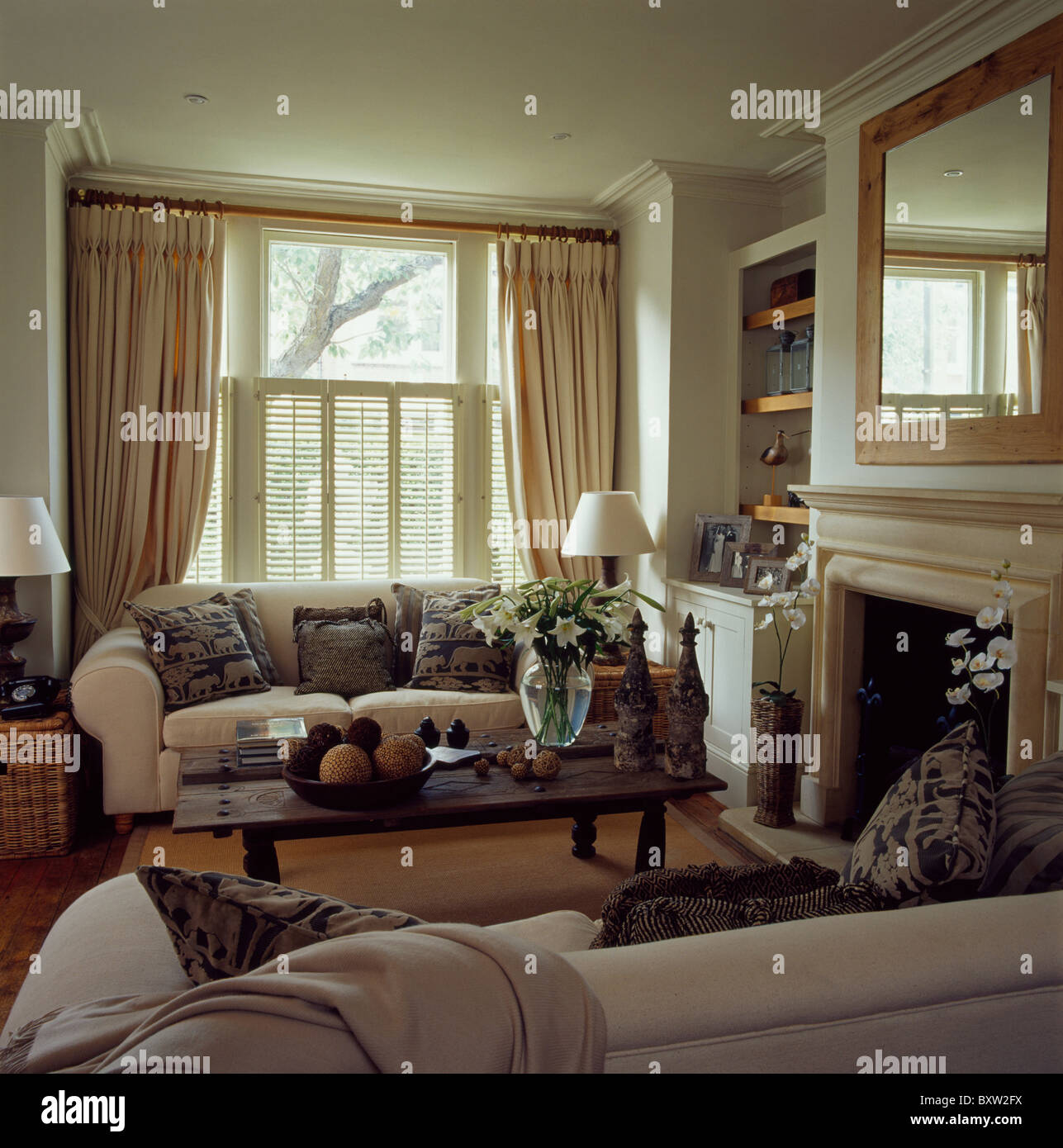 Cream Sofas In Townhouse Living Room With Cream Curtains