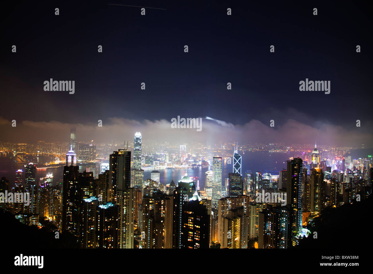 The amazing Hong Kong skyline as seen from above at night. Victoria harbor harbour and Kowloon Stock Photo