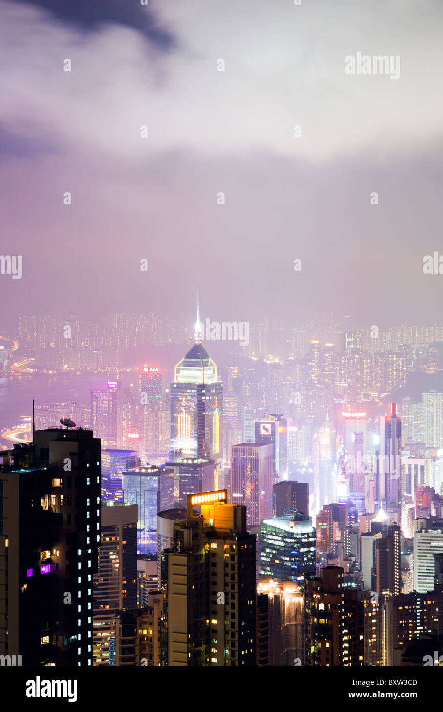 The amazing Hong Kong skyline as seen from The Peak lookout at night. The imposing structures include the central Stock Photo