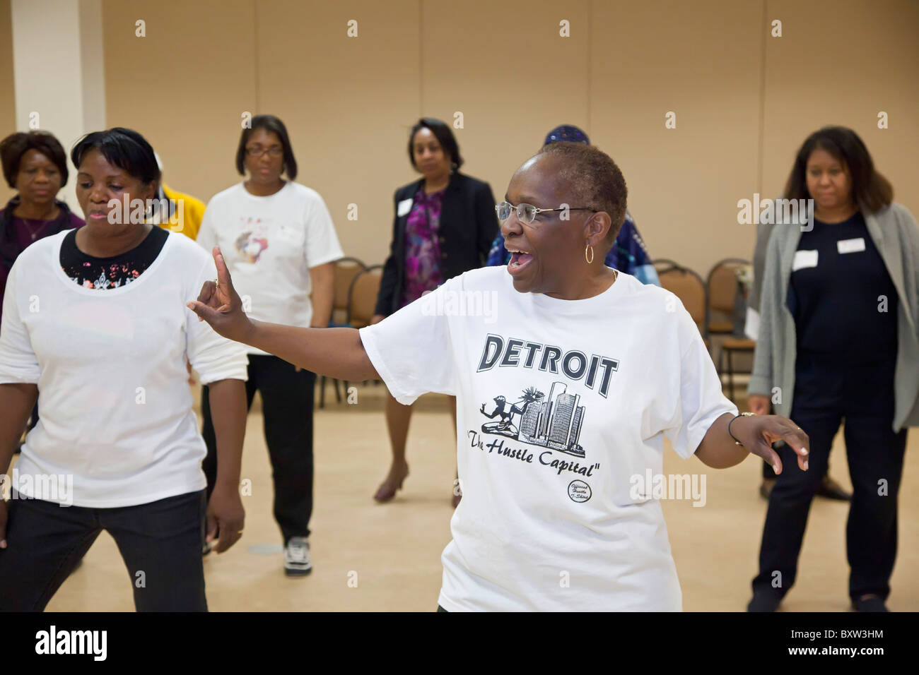 Women Exercise at Workshop on Healthy Living - Stock Image