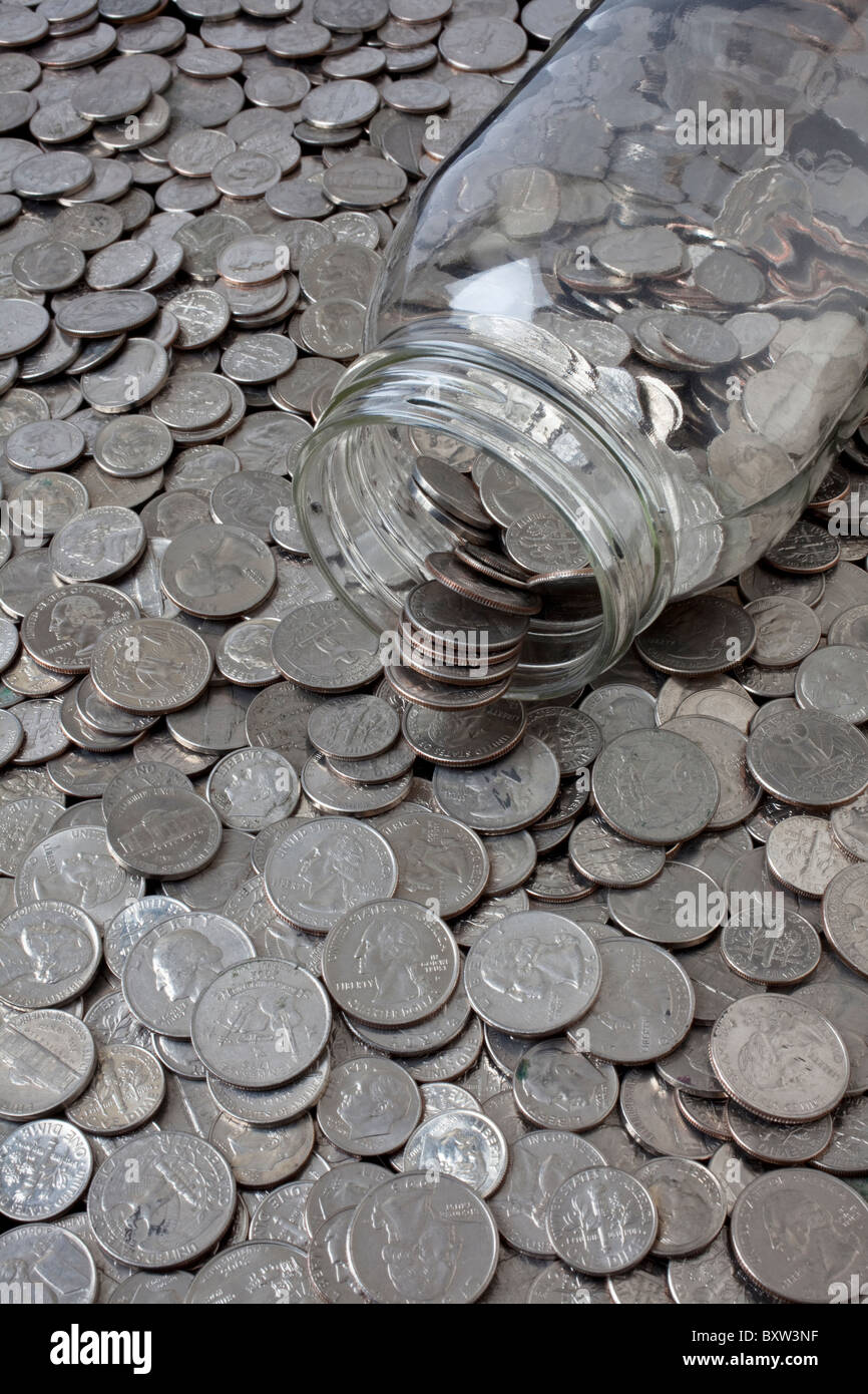 Jar with silver coins - Stock Image