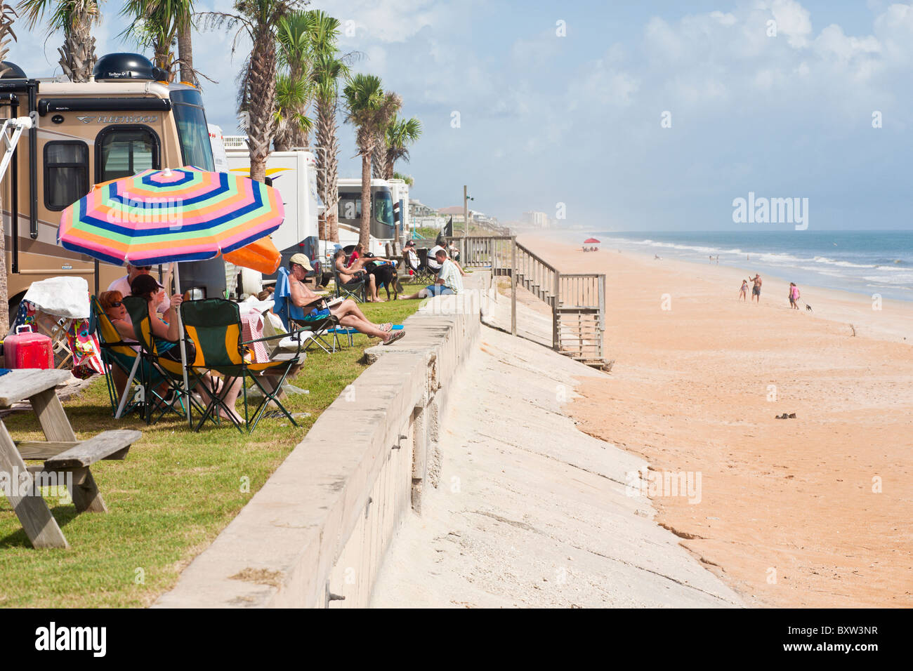 Campers enjoy the beach at a waterfront RV resort at Beverly Beach, Florida - Stock Image