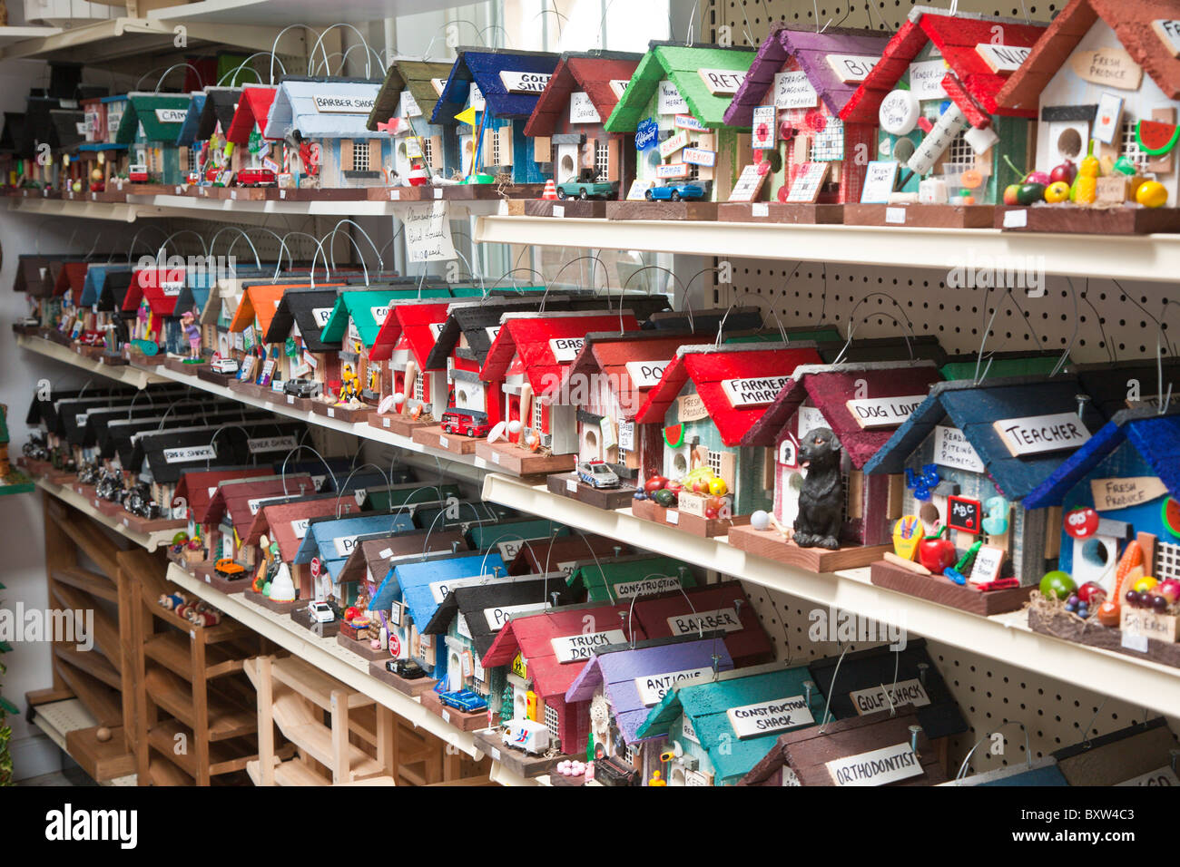 Brightly painted birdhouses representing different occupations for sale in Amish store in Lancaster County, Pennsylvania Stock Photo