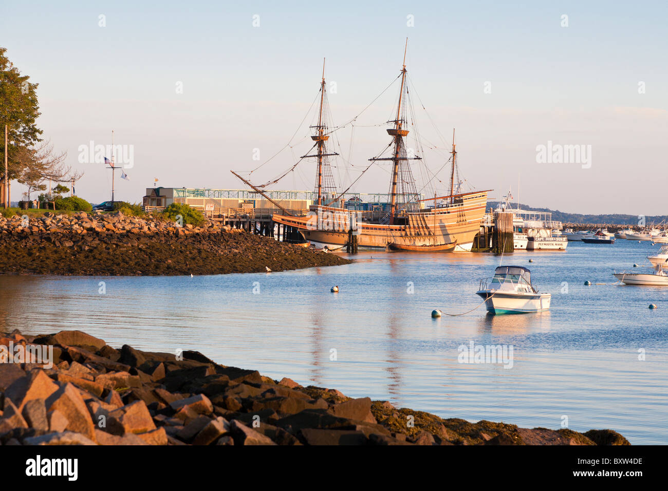 Mayflower II and other boats moored in Plymouth Harbor at dawn in Plymouth Massachusetts Stock Photo