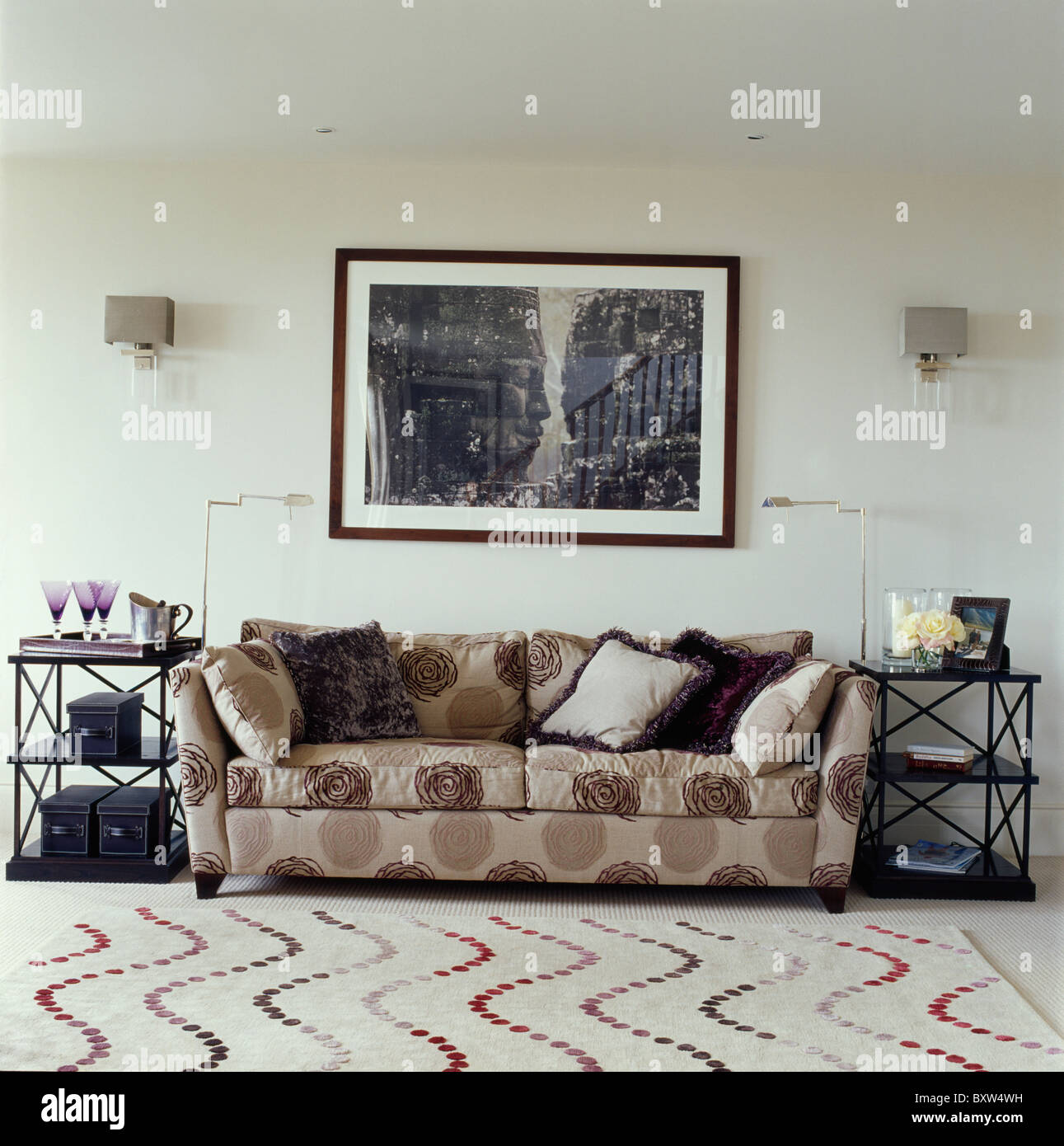 Large Black White Picture Above Patterned Beige Sofa In Modern Living Stock Photo Alamy