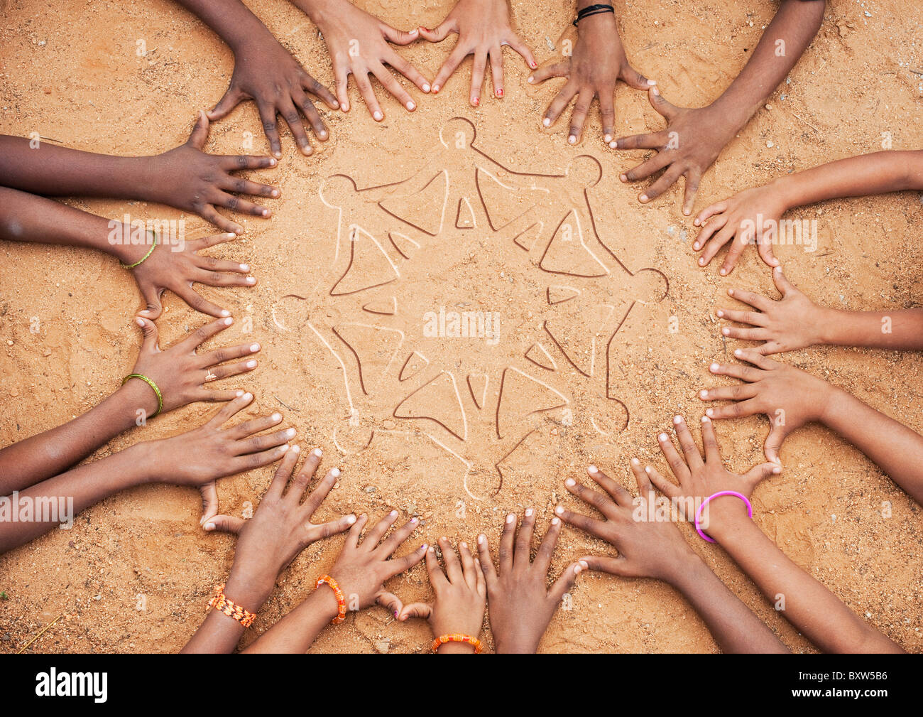 Children's hands forming a circle with a one world symbol in the middle. India - Stock Image
