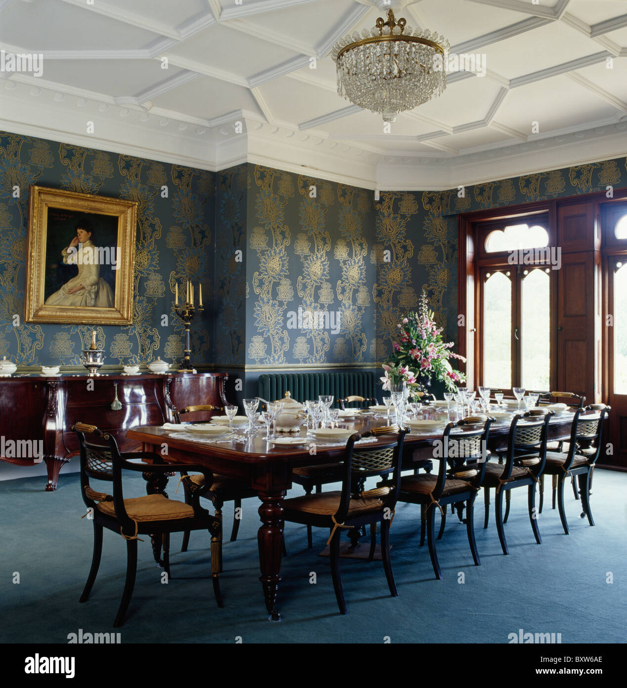 White Tudor ceiling in large country dining room with blue carpet ...