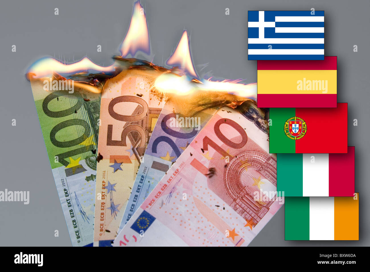 burning bank notes currency crisis of the EUR awaited collapse of the euro symbol picture its death flag pigs piigs - Stock Image