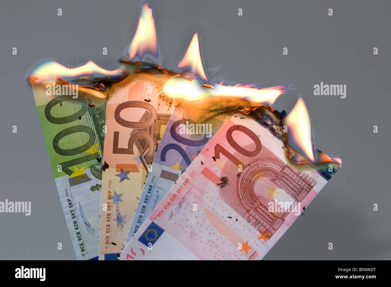 burning bank notes currency crisis of the EUR awaited collapse of the single currency symbol picture for the death - Stock Image