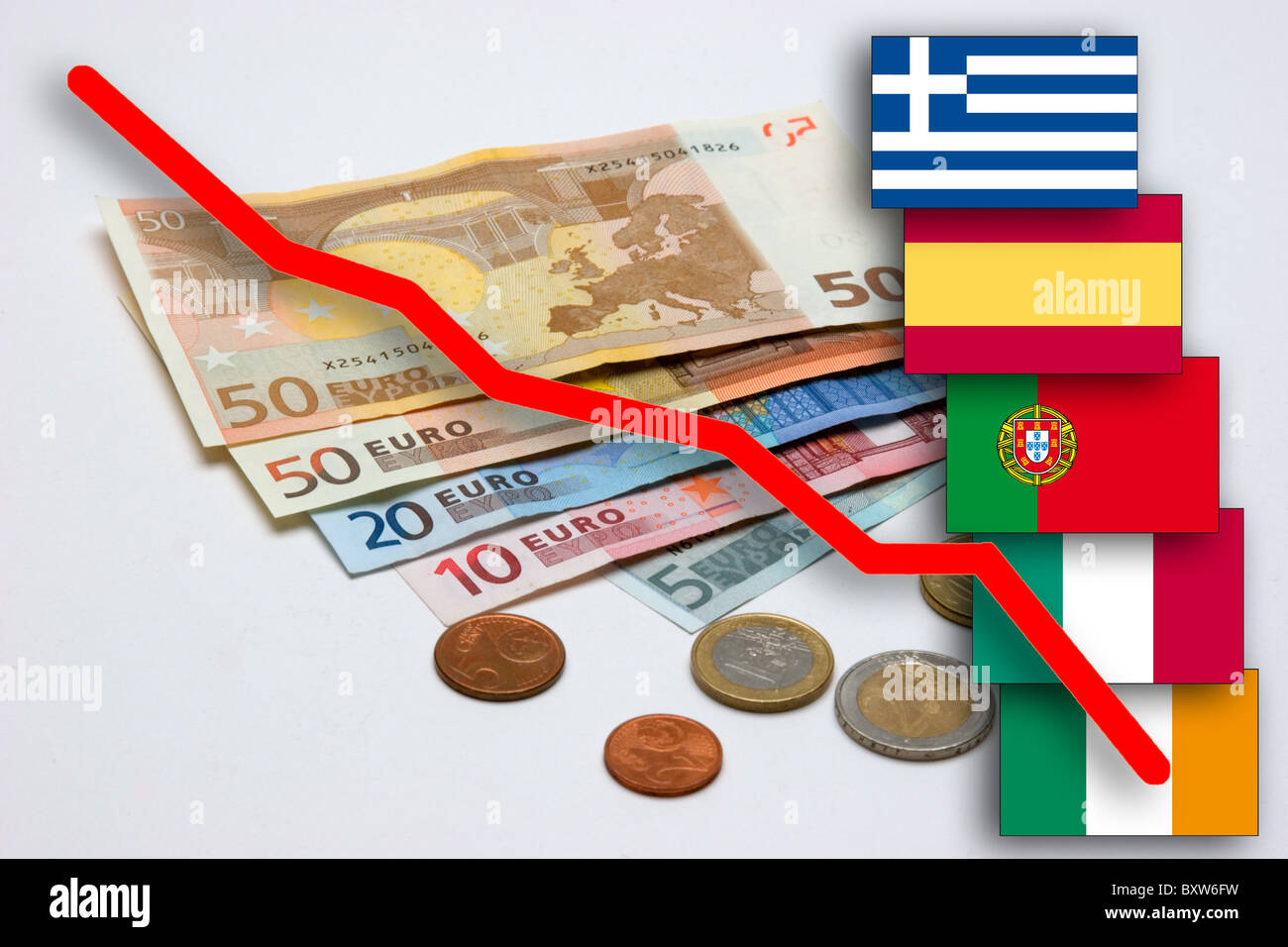 currency crisis of the EUR symbol picture for the loss in value of the Euro with flags of the so called pigs states - Stock Image