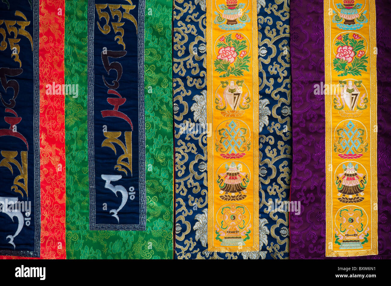 Colourful Tibetan Buddhist wall hangings. Andhra Pradesh, India - Stock Image
