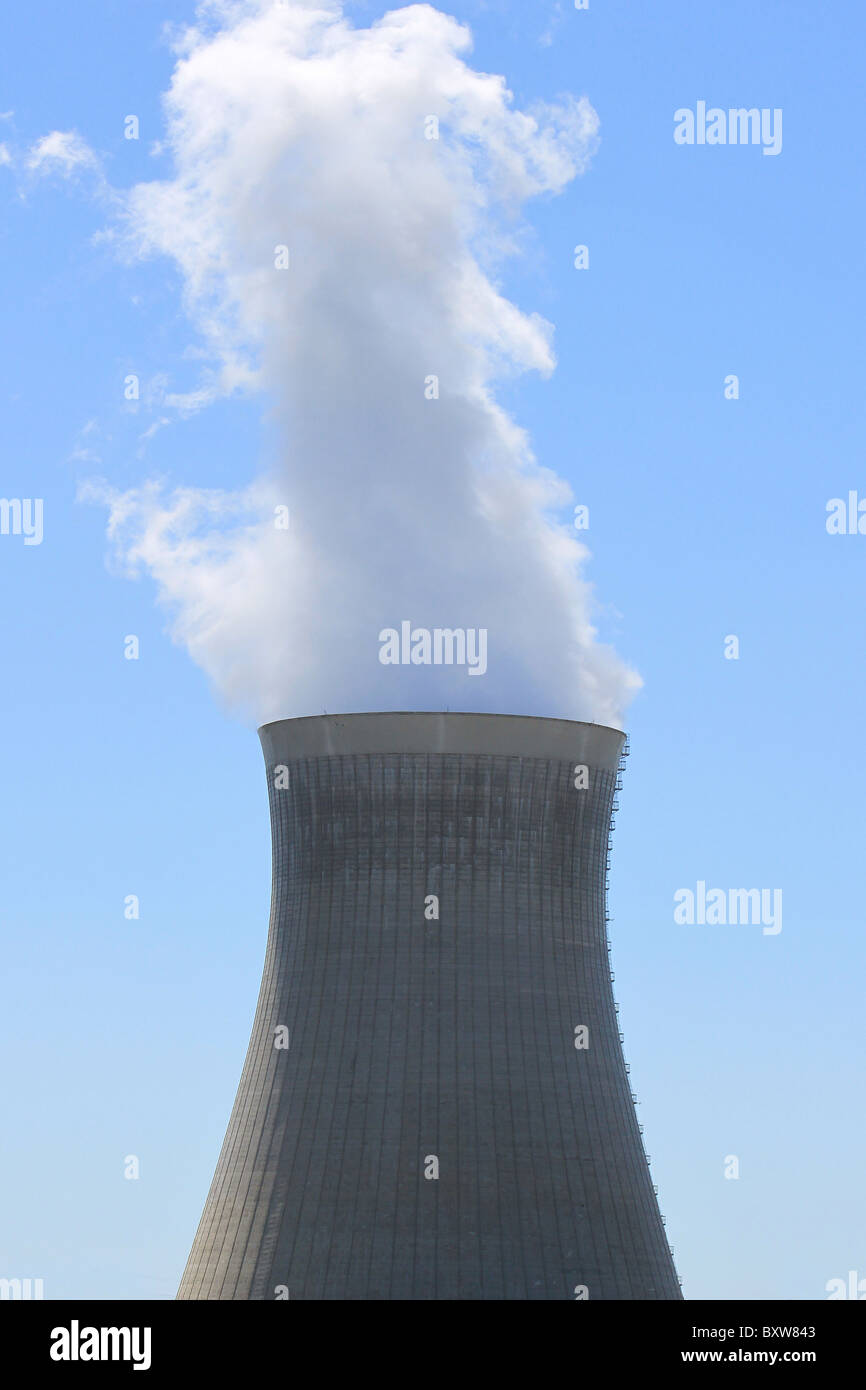 chimney of a nuclear power plant in operation - Stock Image