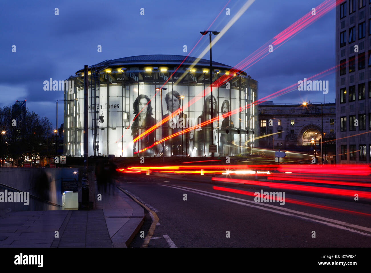 View along Waterloo Bridge to the iTunes Beatles billboard on the IMAX cinema, South Bank, London, UK - Stock Image