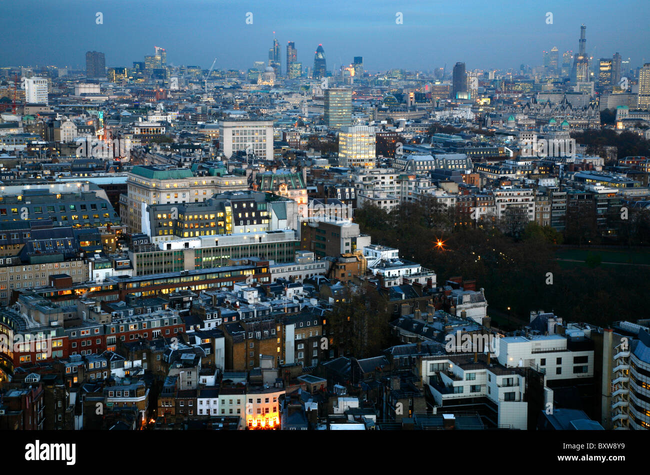 Skyline view looking east over Mayfair, Green Park and St James's towards the City of London, UK - Stock Image