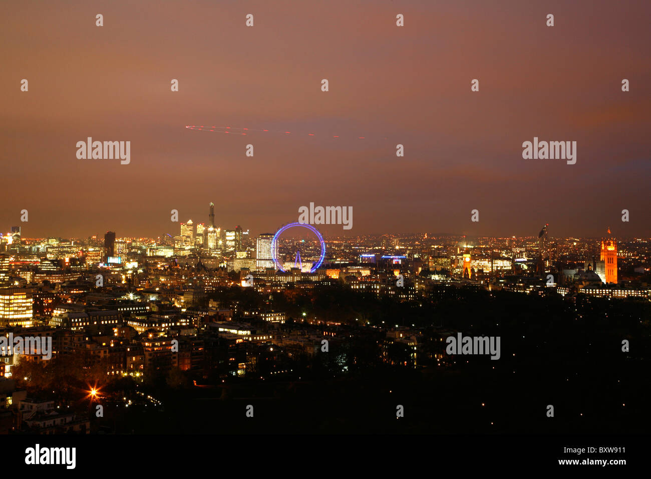 Skyline view looking east over St James's towards Houses of Parliament, London Eye and Canary Wharf, London, - Stock Image