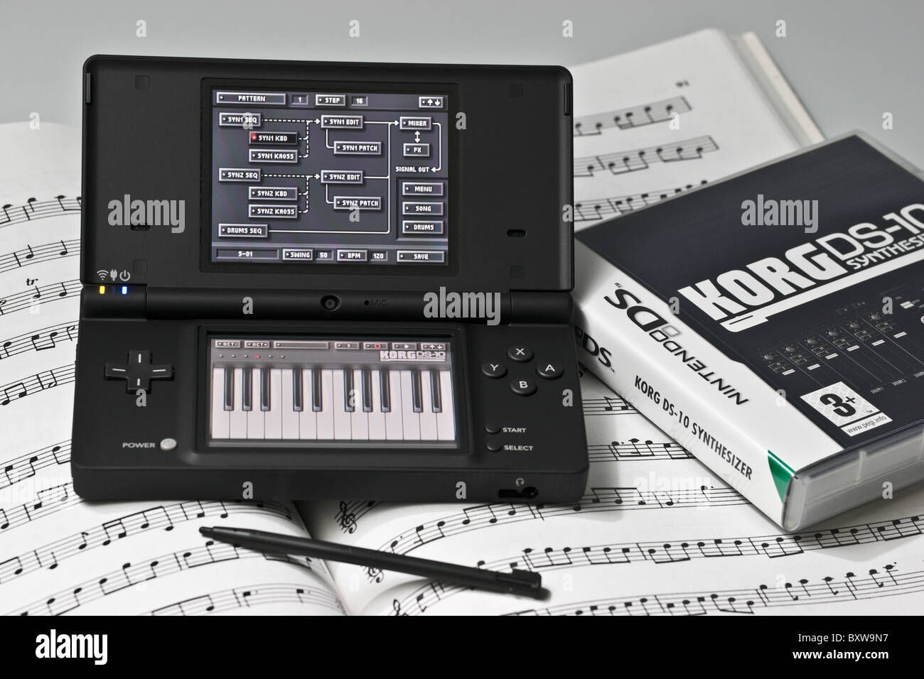 Nintendo DS2 hand held electronic game with Korg DS-10 music synthesizer and sequencer program - Stock Image