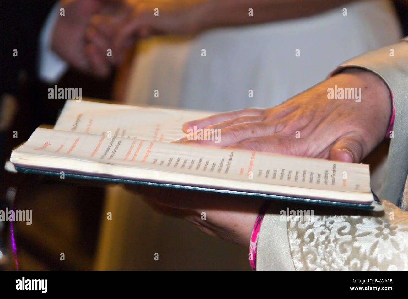Horizontal Close Up Of Wedding Vows Being Read From A Book
